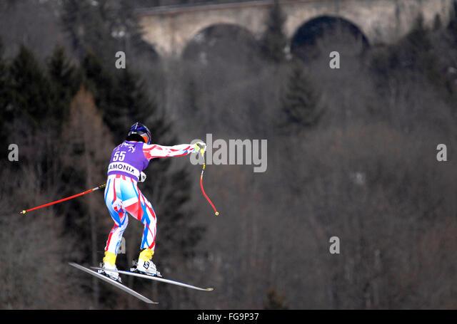 Mens downhill ski racer in the air - Stock-Bilder