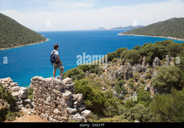 Man looking out at coast on the Lycian way, Turkey - Stock Image