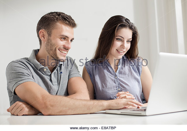 Young couple using laptop - Stock-Bilder