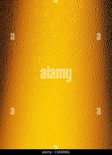 Beer Bottle, Close Up. Showing Condensation on the Bottle Neck. - Stock Image