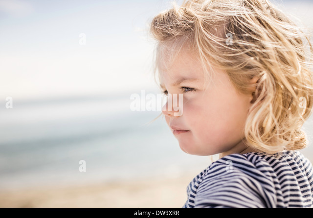 Girl on beach, Port Townsend, Washington, US - Stock Image