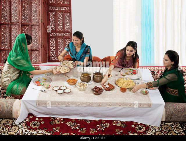 Muslim women having food during Id - Stock Image