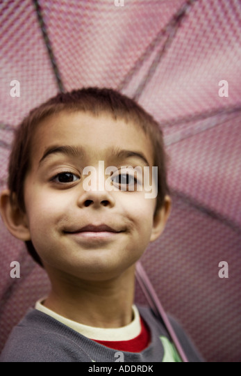 Smiling boy with umbrella - Stock Image