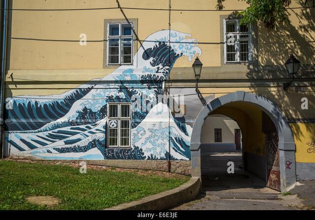 Hokusai Wave painted at the entrance of Grammar School, Tvrdja, Osijek, Slavonia, Croatia - Stock Image