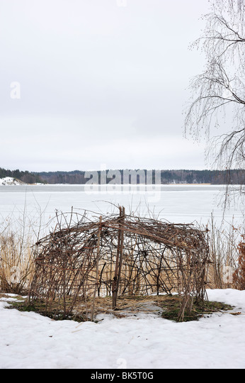 Crib made of branches and sticks. - Stock Image
