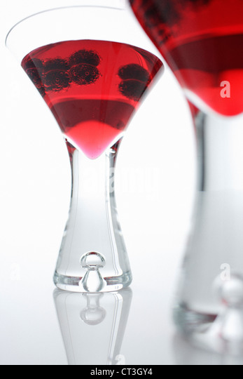 Glasses of juice with berries - Stock Image