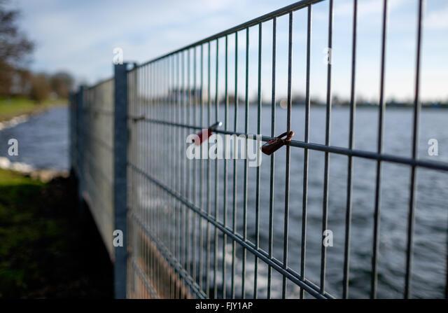 Padlocks On Railing By Sea - Stock Image