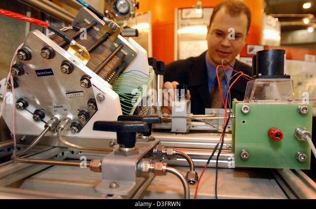 (dpa) - Frank Uphorst adjusts a test facility for fuel cells of the University of Dortmund at the 'E-World  - Stock Image