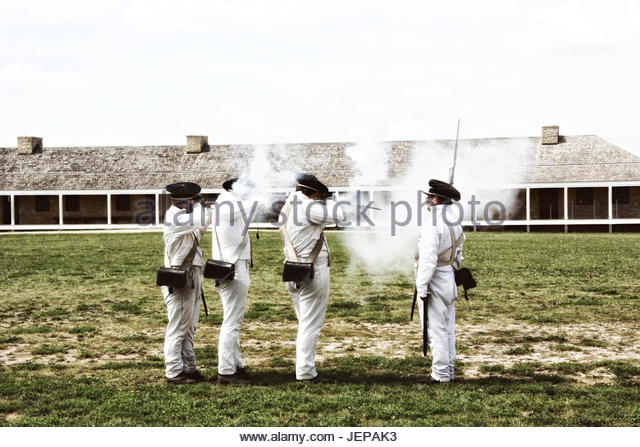 1800's US military men firing muskets - Stock Image