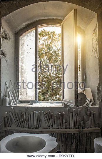 Sunlight through window into artist's studio - Stock Image
