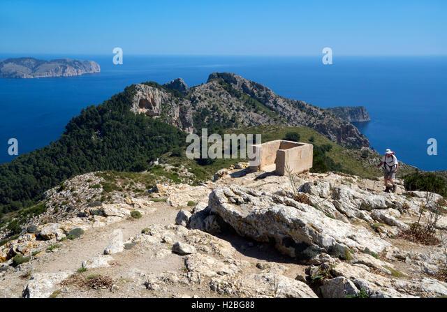 Trekker arriving to the hilltop Atalaya de Alcudia. Mallorca Island. Spain - Stock Image