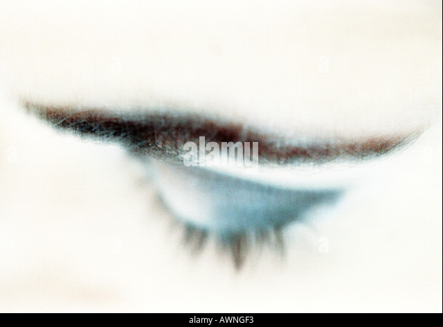 Woman's closed eye with blue eye shadow, close-up, high angle view, blurry. - Stock-Bilder