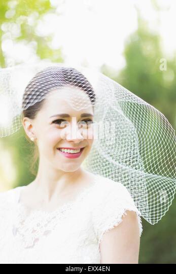 Portrait of smiling bride - Stock Image