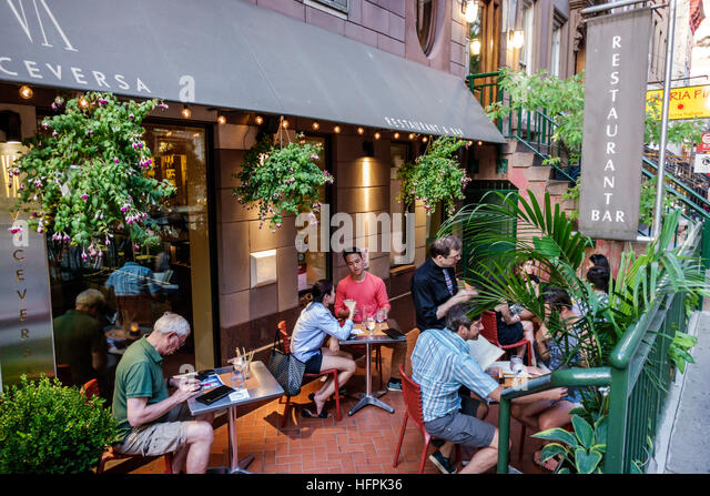 Manhattan New York City NYC NY Hell's Kitchen ViceVersa Italian restaurant bar alfresco dining Asian man woman - Stock Image