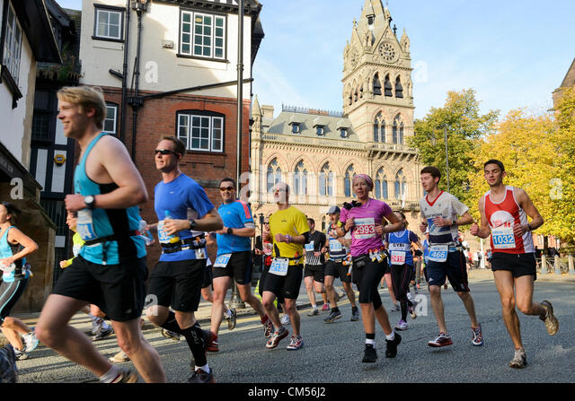 7th October 2012, Chester UK. Shortly after the start of the MBNA Chester Marathon, runners pass in front of the - Stock Image