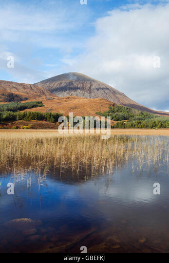 Beinn Na Caillich overlooking the reed infilled Loch Cill Chriosd, Isle of Skye, Scotland - Stock Image