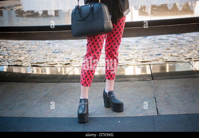 Fashionistas in their finery outside of the Fall 2014 Fashion Week shows in Lincoln Center in New York - Stock Image