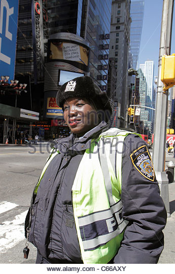 Manhattan New York City NYC NY Midtown Times Square street scene Black woman NYPD police officer public safety law - Stock Image