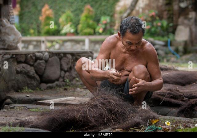 Man Working hard in Tenganan Village, Bali - Stock Image