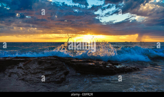 Australia, Western Australia, Coastline at sunset - Stock Image
