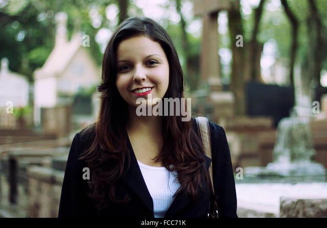 Portrait Of A Smiling Teenage Girl - Stock Image