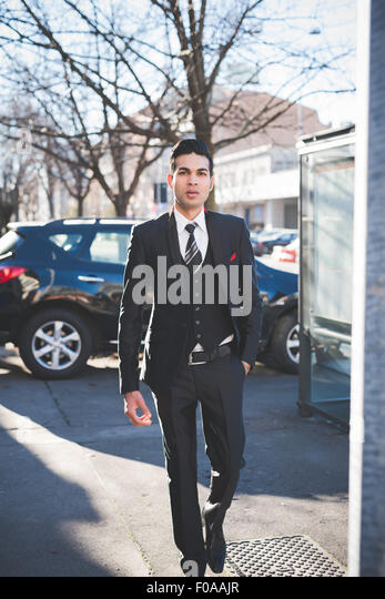 Young businessman in the street, Milan, Italy - Stock Image