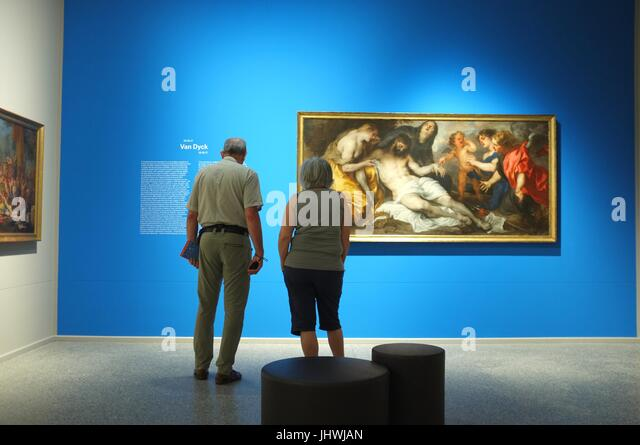 A couple looking at The Lamentation Over The Dead Christ (1650-1670) by Antoon van Dyck, Accademia Carrara, Bergamo, - Stock Image