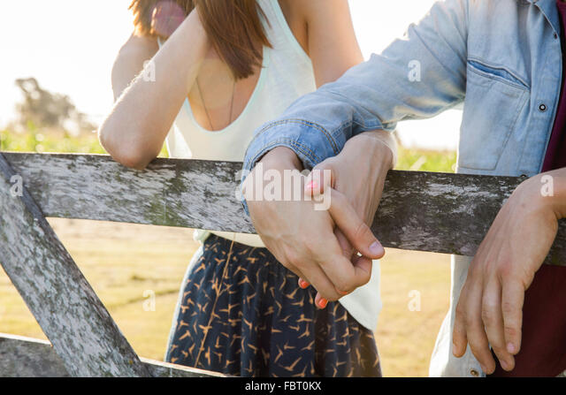 Young couple holding hands, close-up - Stock-Bilder