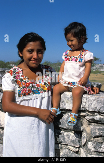Yucatan Maya mother child traditional costume - Stock Image