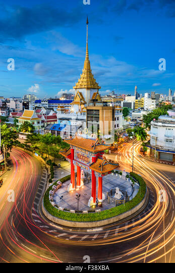 Bangkok, Thailand at Chinatown's traffic circle and Wat Traimit. - Stock Image