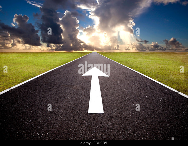 The road to the sunrise and forward mark - Stock Image
