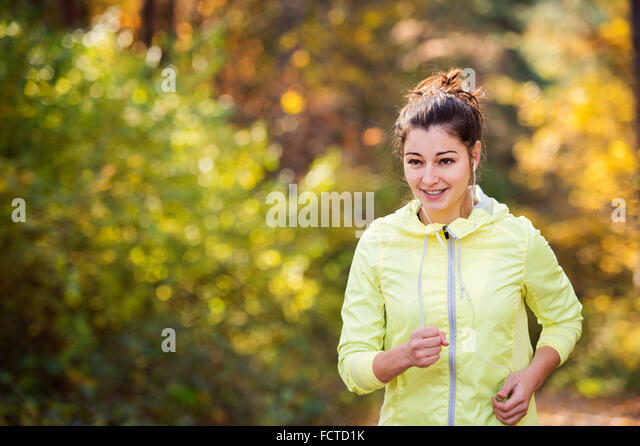 Young woman running - Stock Image