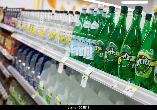 Perrier and San Pellegrino bottled water on display at a Walgreens Flagship store. - Stock Image