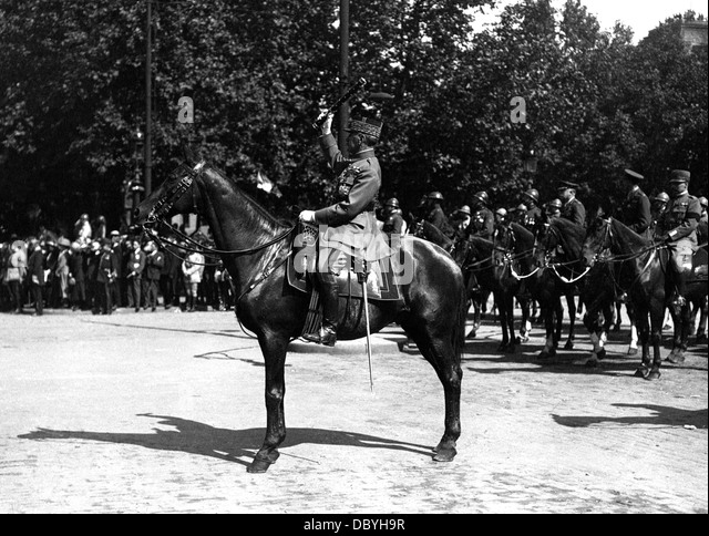 Marshal Ferdinand Foch, on horseback, saluting the troops with his baton, during the Victory Parade in Paris, July - Stock Image