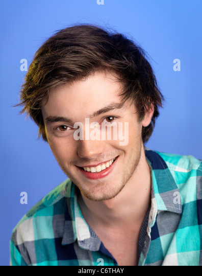 Young man shot on a blue background - Stock Image
