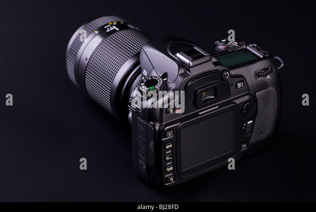 DSLR isolated on black with copy space. - Stock Image