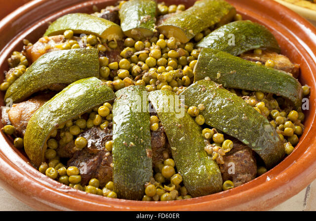 Traditional Moroccan dish with lamb, peas and courgette close up - Stock Image