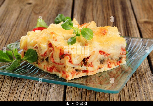 Portion of tasty lasagna on a plate - Stock Image