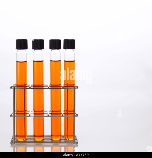 test tube with orange color fluid - Stock Image