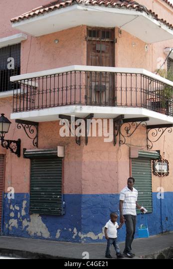 Santo Domingo Dominican Republic Ciudad Colonial Calle Luperon residential neighborhood street corner sidewalk building - Stock Image