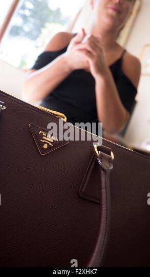 Young female with Prada bag purse handbag - Stock Image