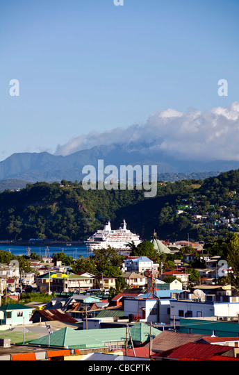 Roseau Dominica city overview above with cruise ship in Eastern Caribbean harbor - Stock Image