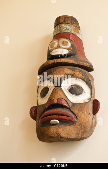 Alaska. Tlingit ceremonial mask exhibit in the Wrangell Museum, Wrangell, Southeast Alaska. - Stock Image