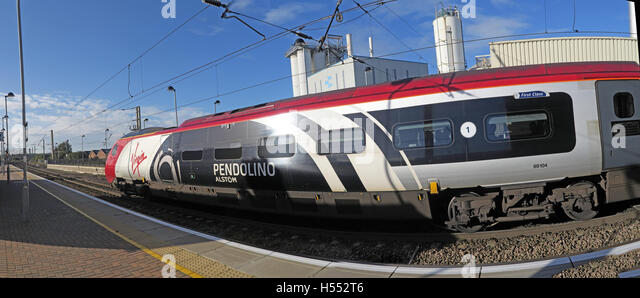 Panorama Pendolino at Warrington, Bank Quay Station, WCML, Cheshire, England UK - Engine 69104 - Stock Image