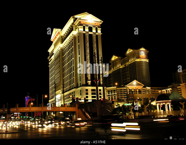 Las Vegas Caesars Palace at night  strip skyline at night bright neon lights landmark building casino architecture - Stock Image