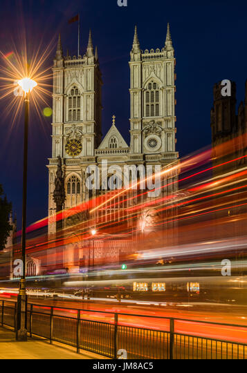 Red London buses and lights at Westminster Abbey, Westminster, London, UK - Stock Image