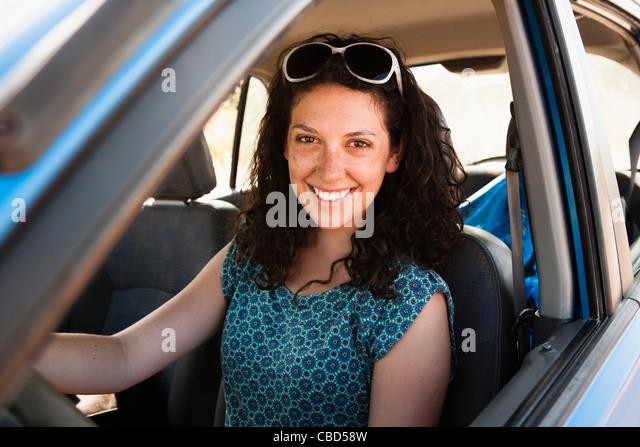 Smiling woman driving car - Stock Image
