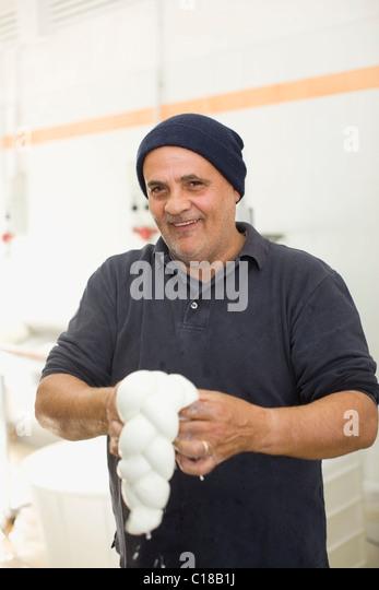 Bison mozzarella manual production - Stock Image