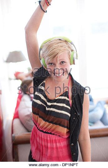 Woman listening to headphones - Stock-Bilder
