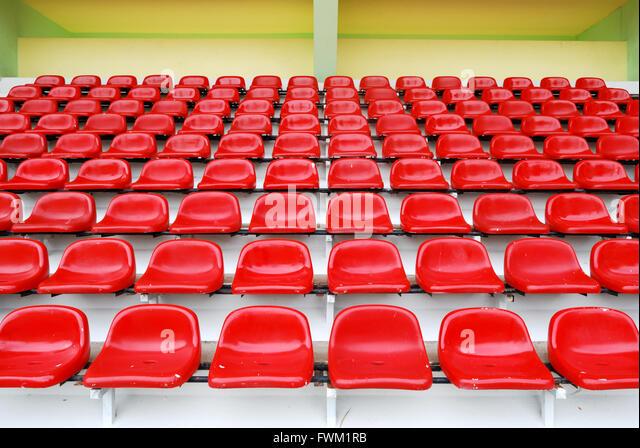 Red Bleachers In Sport Stadium - Stock Image